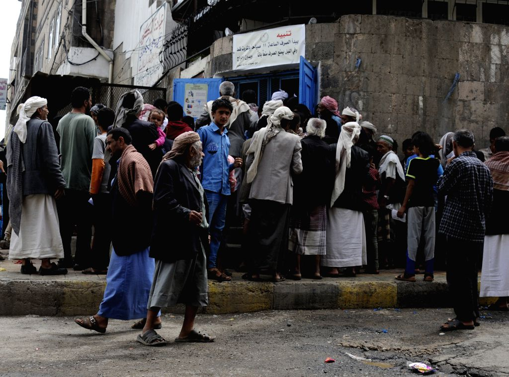 SANAA, Aug. 15, 2017 - People gather to receive bread from a charity center in Sanaa, Yemen, on Aug. 15, 2017. Auke Lootsma, UN Development Program (UNDP) Country Director, said on Aug. 1 that the ...