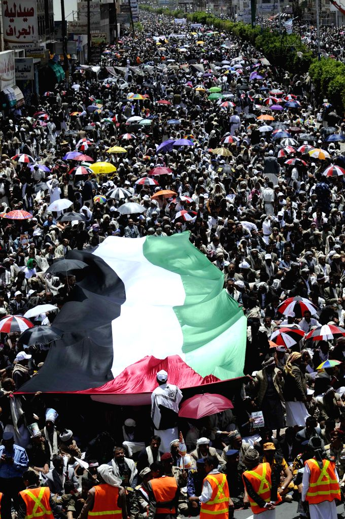 Yemeni protestors march in Sanaa, Yemen, on Aug. 22, 2014. Tens of thousands of protestors, most of them supporters of the Shiite Houthi group, rallied in Sanaa, ...