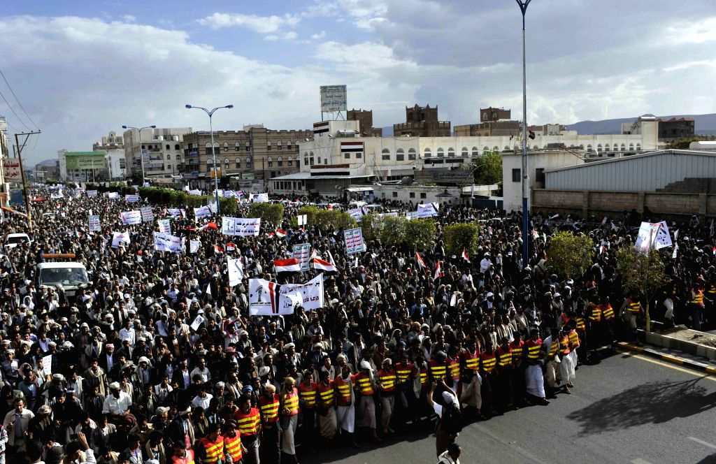 Yemeni people take part in a march in Sanaa, Yemen, on Aug. 27, 2014, to celebrete the seasefire deal between Israel and Palestinian factions. A ceasefire came into ..