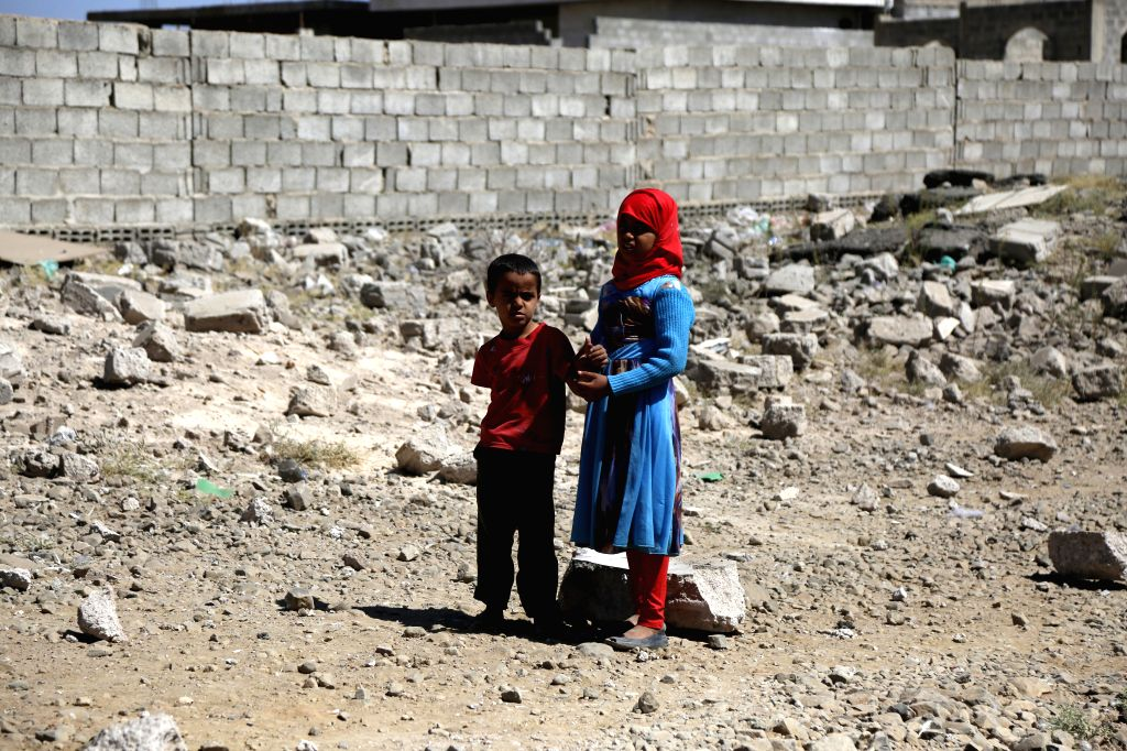 SANAA, Feb. 1, 2019 - A boy and his sister stand on rubble of a house hit by airstrikes in Sanaa, Yemen, on Feb. 1, 2019. Local residents Friday said the targeted hangar by the Saudi-led coalition ...