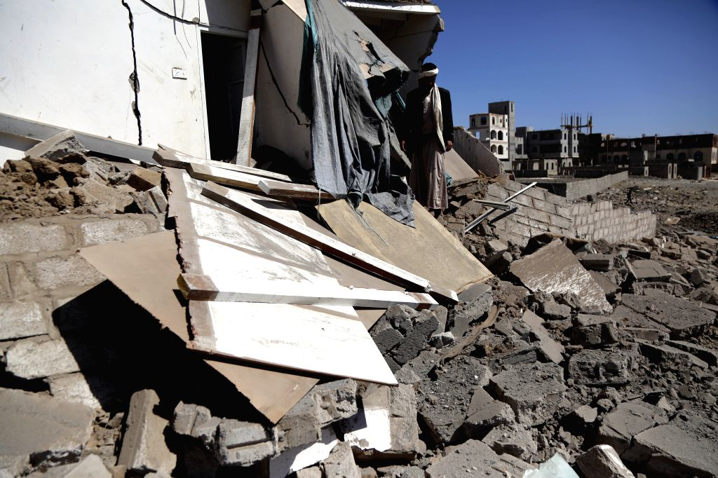 SANAA, Feb. 1, 2019 (Xinhua) -- A man inspects a house hit by airstrikes in Sanaa, Yemen, on Feb. 1, 2019. Local residents Friday said the targeted hangar by the Saudi-led coalition overnight airstrikes was not a military site. Saudi-owned Al Arabiya