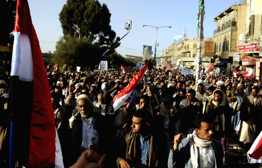 Yemeni people shout slogans during a rally marking the fourth anniversary of the 2011 revolution, in which former President Ali Abdullash Saleh was forced to step ...