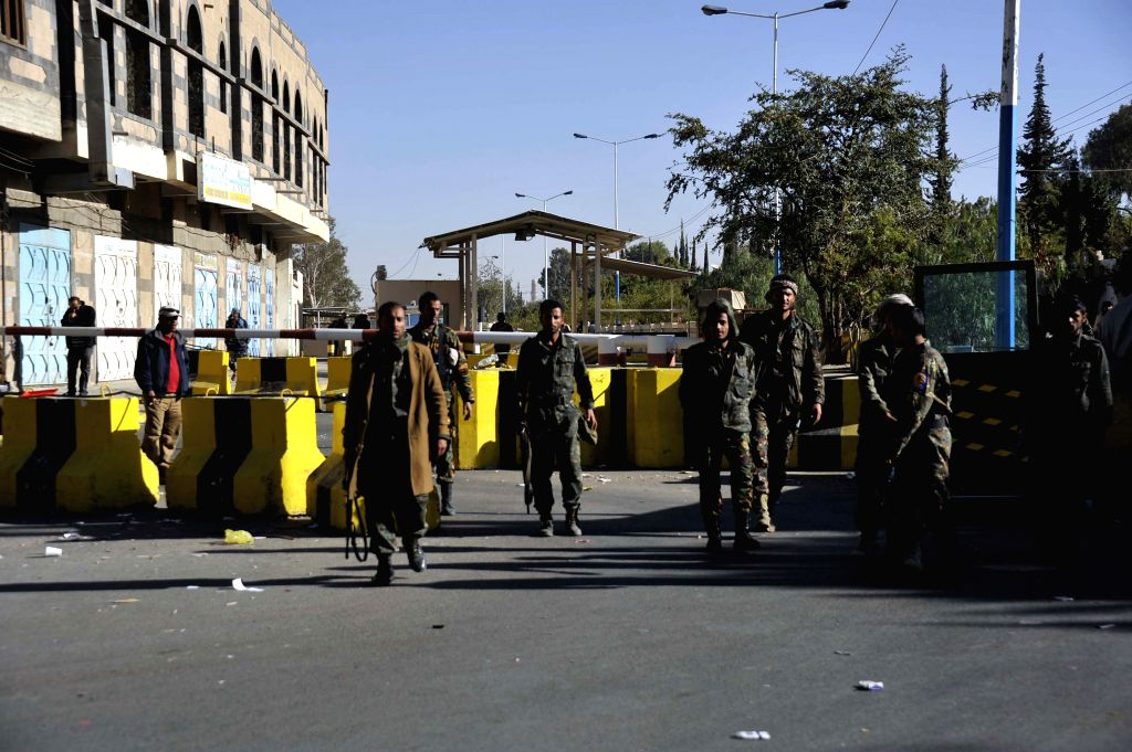 Yemeni soldiers stand guard outside the U.S. embassy in Sanaa, Yemen, Feb. 11, 2015, one day after the U.S. State Department announced the suspension of operations of