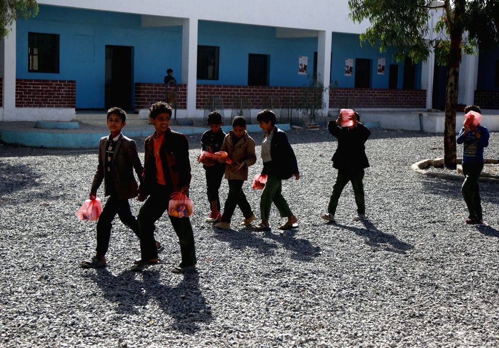 SANAA, Feb. 13, 2019 - Yemeni conflict-affected students walk carrying aided breakfast at a school in Sanaa, Yemen, on Feb. 13, 2019.  Ahmed Hameed Humran, head of a school in north of Sanaa, said ...