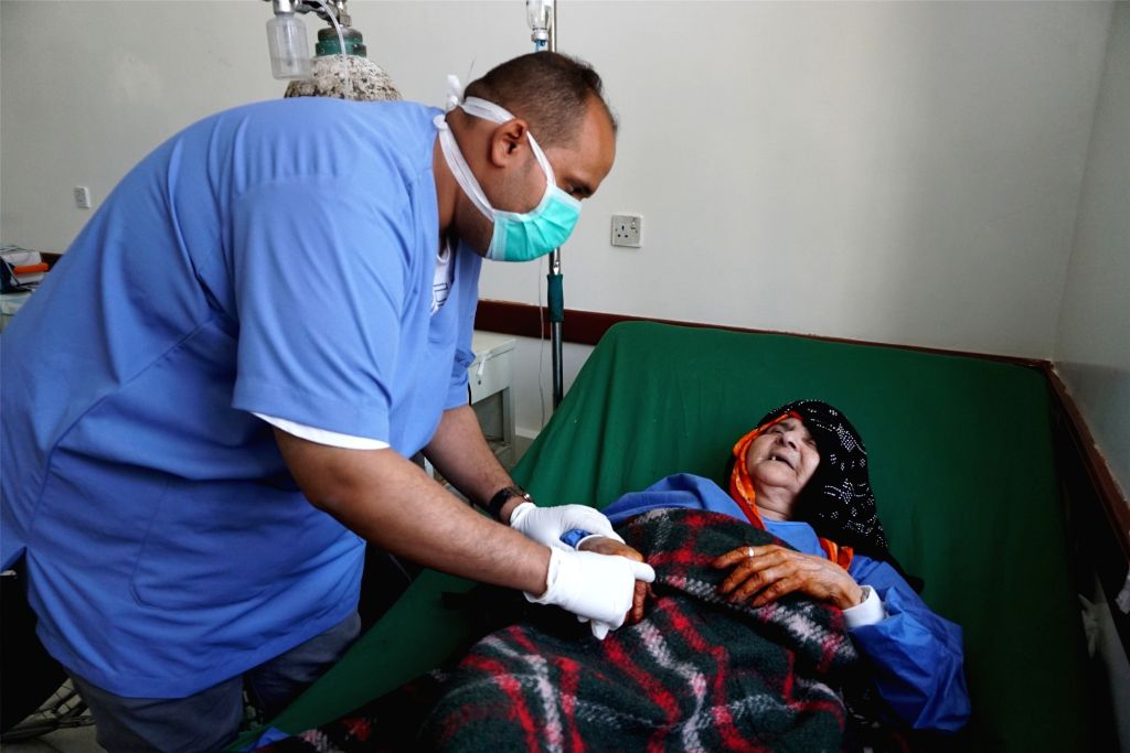 SANAA, Feb. 17, 2019 - Aminah Mohsen (R), 70, receives medical treatment for H1N1 in a hospital in Sanaa, Yemen, on Feb. 17, 2019. Aminah Mohsen is suffering from swine flu, also known as H1N1 ...