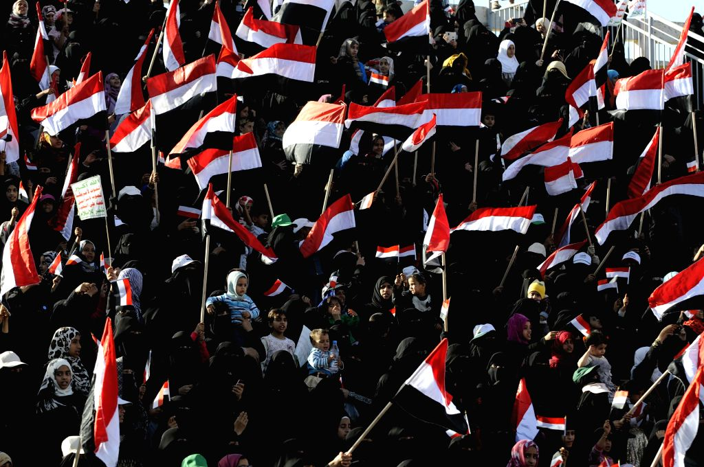 Supporters of the Shiite Houthi Group attend an event celebrating the group's taking over the control of the country at a stadium in Sanaa, Yemen, Feb. 7, 2015. The ...