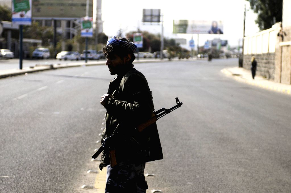 A Shiite Houthi fighter walks on the street during clashes with presidential guards near the presidentail palace in Sanaa, Yemen, on Jan. 19, 2015. (Xinhua/Hani ...