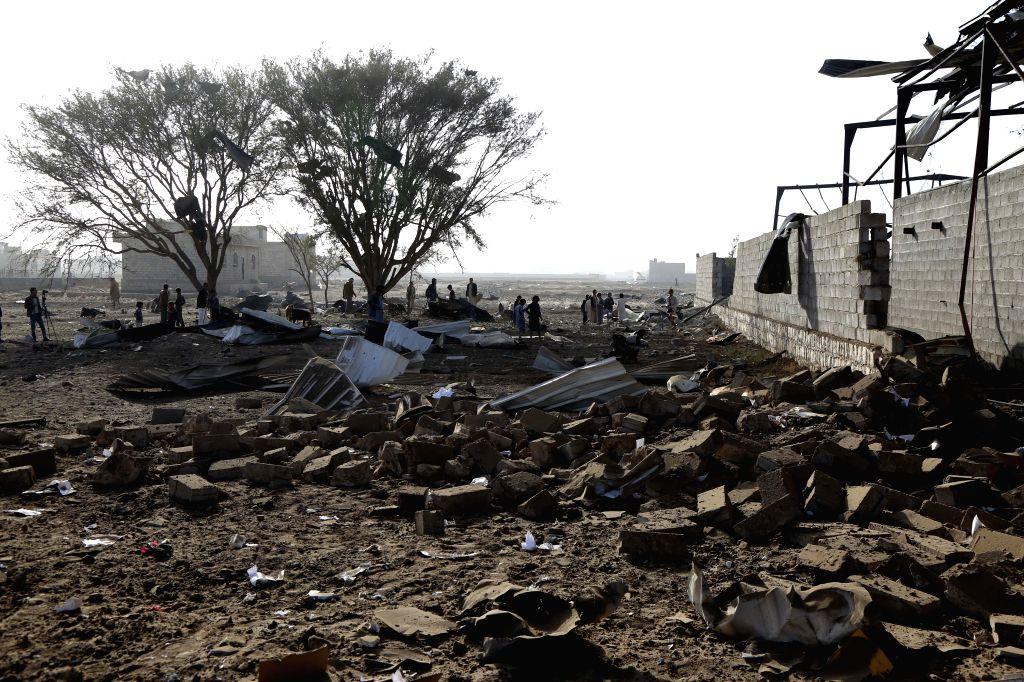 SANAA, Jan. 20, 2019 - People inspect a site hit by airstrikes last midnight in Sanaa, Yemen, on Jan. 20, 2019. Four powerful Saudi-led coalition airstrikes hit Yemen's rebel-held capital Sanaa at ...