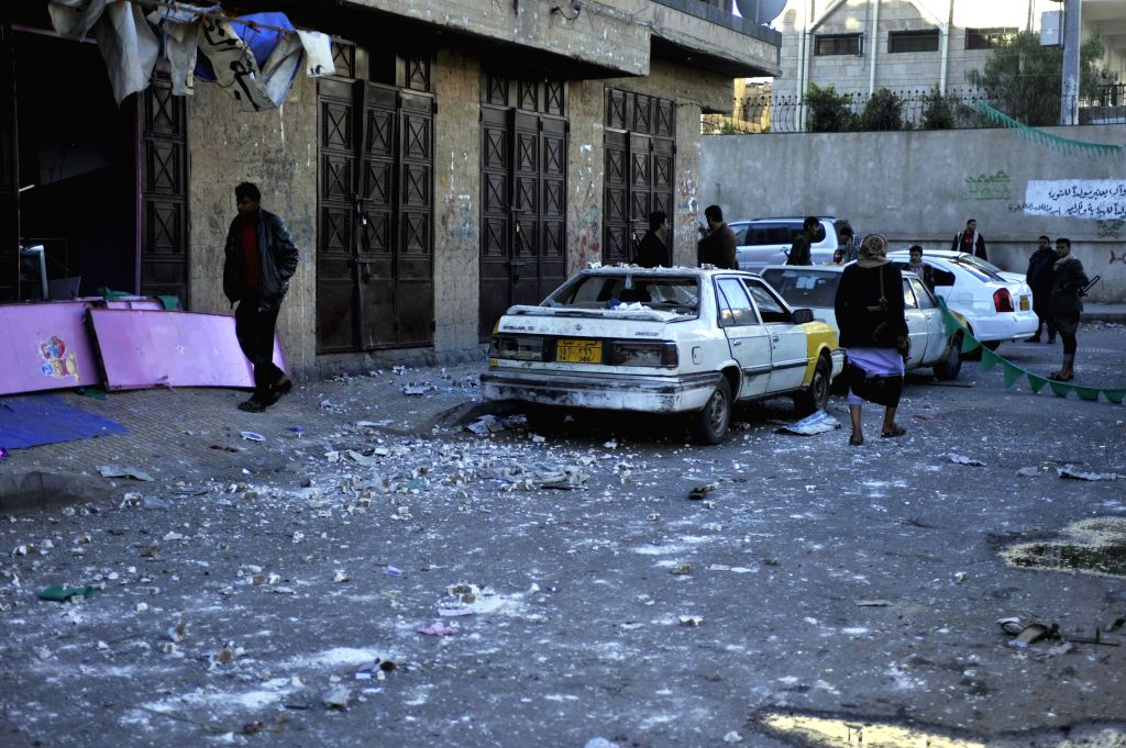 Houthi militants gather at the site where an office of the Shiite Houthi group were hit by a bomb in Sanaa, Yemen, on Jan. 5, 2015. An explosive device went off at an .
