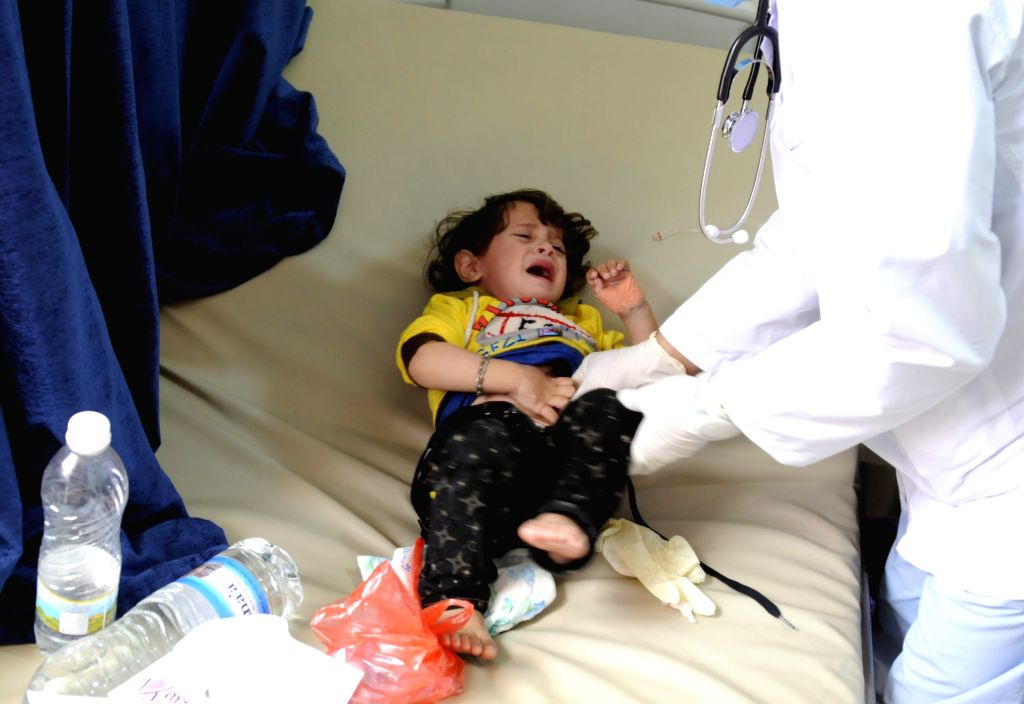 SANAA, July 2, 2017 - A doctor checks a cholera-infected baby at a hospital in Sanaa, Yemen, on July 1, 2017. The World Health Organization said on Saturday that a cholera outbreak in war-torn Yemen ...