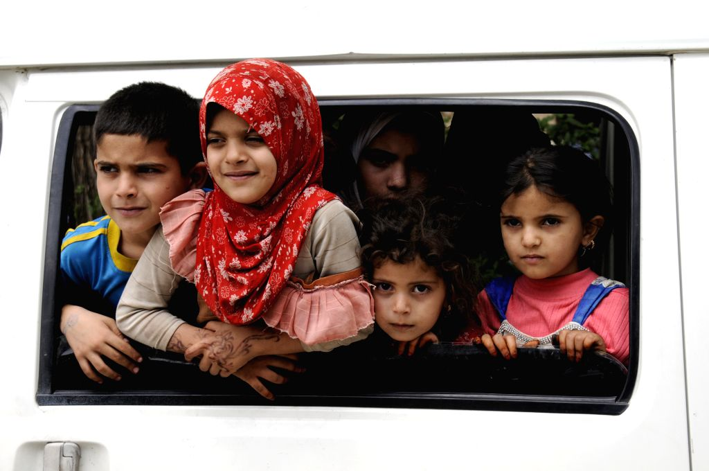 SANAA, July 2, 2017 - Children look out from a bus outside a cholera-separated department at a hospital in Sanaa, Yemen, on July 1, 2017. The World Health Organization said on Saturday that a cholera ...