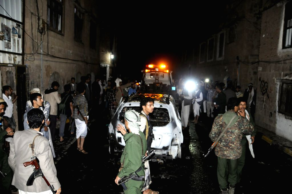 People gather around the scene of a bomb blast targeting Shiite Houthi leader Abdullah al-Mutawakil in Sanaa, Yemen, on July 19, 2014. Abdullah al-Mutawakil survived .