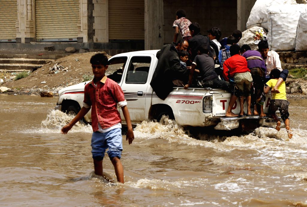 SANAA, July 27, 2019 - A car runs in floodwater after heavy rain in Sanaa, Yemen, July 26, 2019. Heavy rains and flood frequently hit many governorates in Yemen this summer. (Photo by Mohammed ...