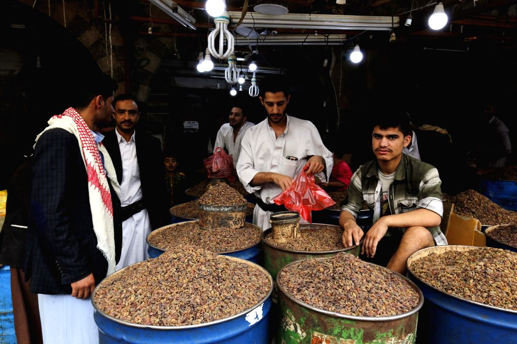 SANAA, July 5, 2016 - Yemenis shop to prepare for the Eid al-Fitr at a traditional market in Sanaa, Yemen, on July 5, 2016. Muslims around the world prepare for the Eid al-Fitr which marks the end of ...