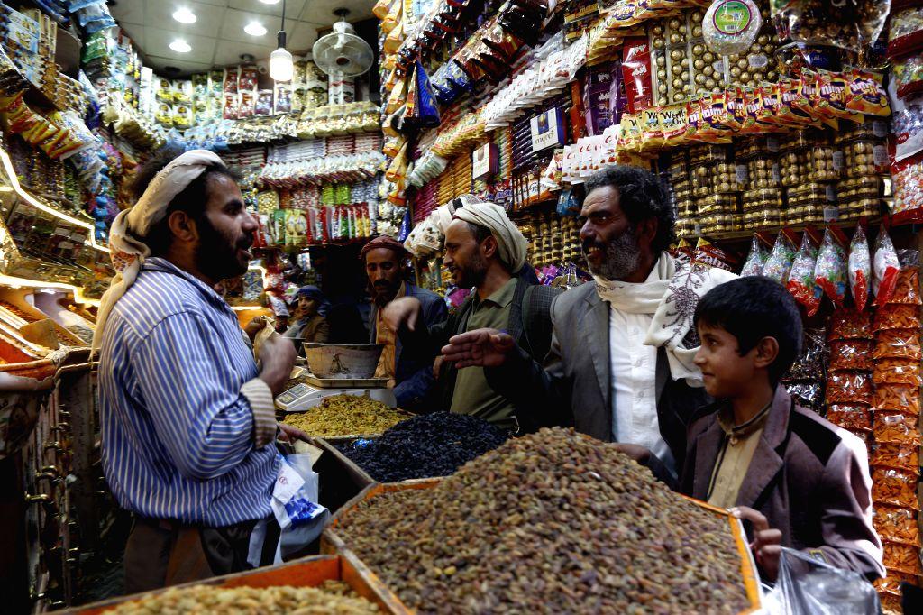 SANAA, June 1, 2019 - Yemenis buy sweets ahead of the Eid al-Fitr at a market in Sanaa, Yemen, June 1, 2019.