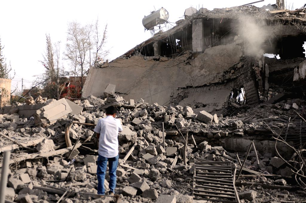 SANAA, June 6, 2018 - A man looks at the ruins of a destroyed house owned by his family after the airstrikes in Sanaa, Yemen, on June 6, 2018. Saudi-led coalition launched a series of airstrikes on ...