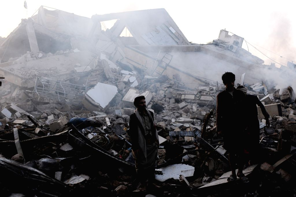 SANAA, June 6, 2018 - People inspect the ruins of a destroyed building hit by airstrikes in Sanaa, Yemen, on June 6, 2018. Saudi-led coalition launched a series of airstrikes on the Yemeni capital on ...
