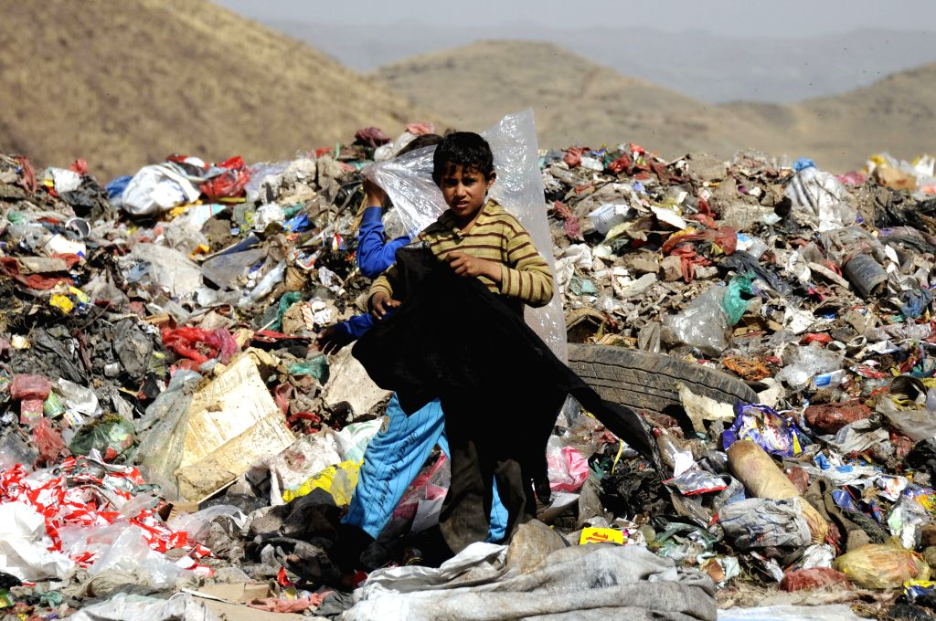 SANAA, March 12, 2017 - A boy stands at a garbage dump as he is searching for recyclable items to be sold to support his family in Sanaa, Yemen, on March 11, 2017.