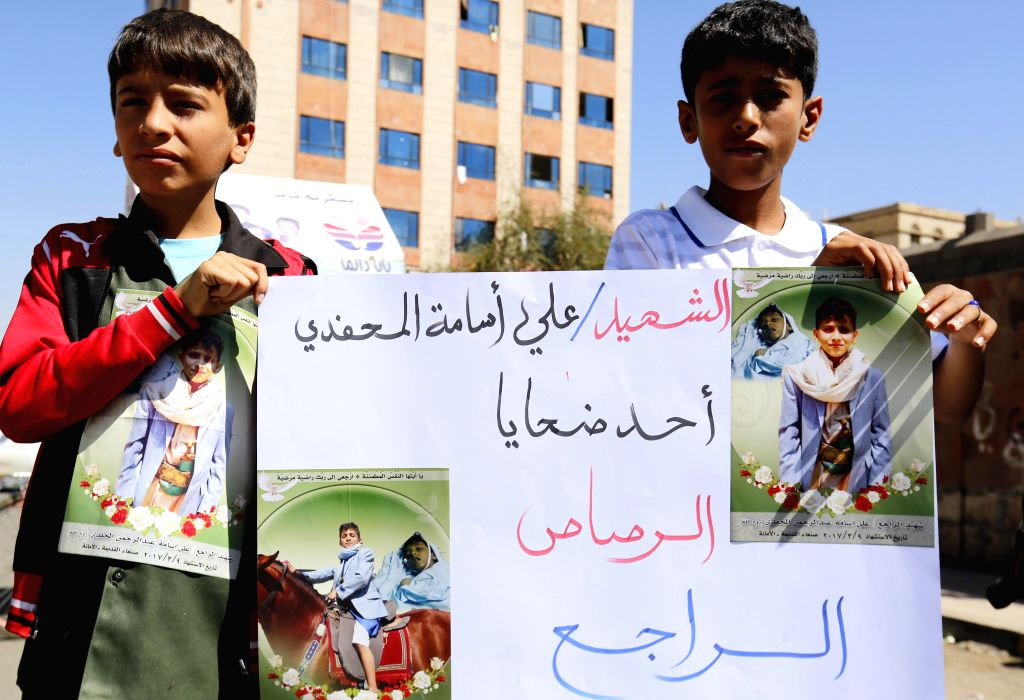 SANAA, March 13, 2017 - Children protest against carrying weapons and firing in the air to cause casualties by stray bullets in Sanaa, capital of Yemen, on March 13, 2017.