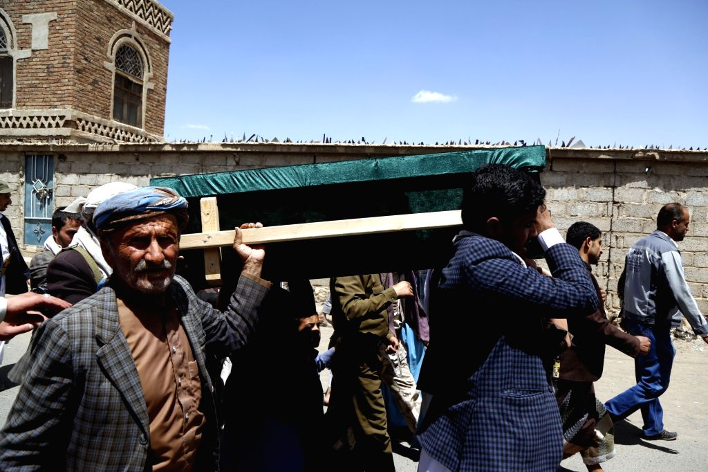 SANAA, March 14, 2019 - People carry a coffin of a child who was killed in an airstrike in Hajjah province during a funeral procession, in Sanaa, Yemen, on March 14, 2019.