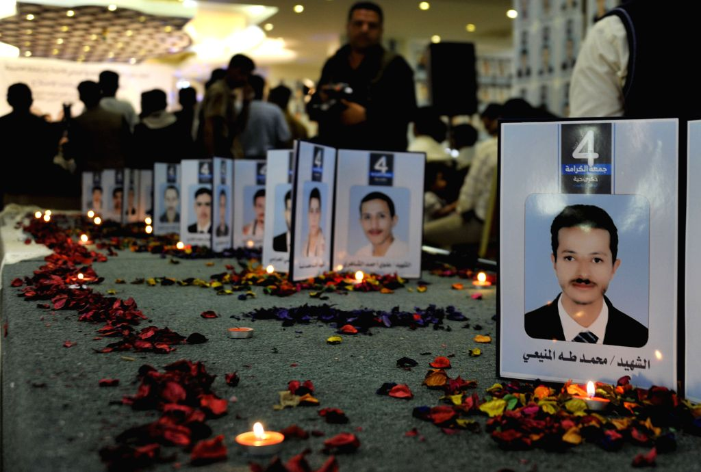 Pictures of victims were shown at a ceremony held to commemorate the 4th anniversary of an anti-government protest in Sanaa, Yemen, March 17, 2015. More than 50 ...