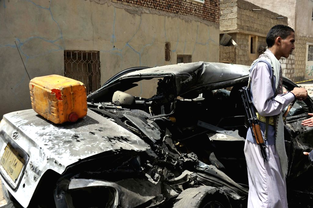 A damaged car is seen at the blast site in Sanaa, Yemen, on March 21, 2015. The Islamic State (IS) carried out a series of suicide bombing attacks in Sanaa and the ...