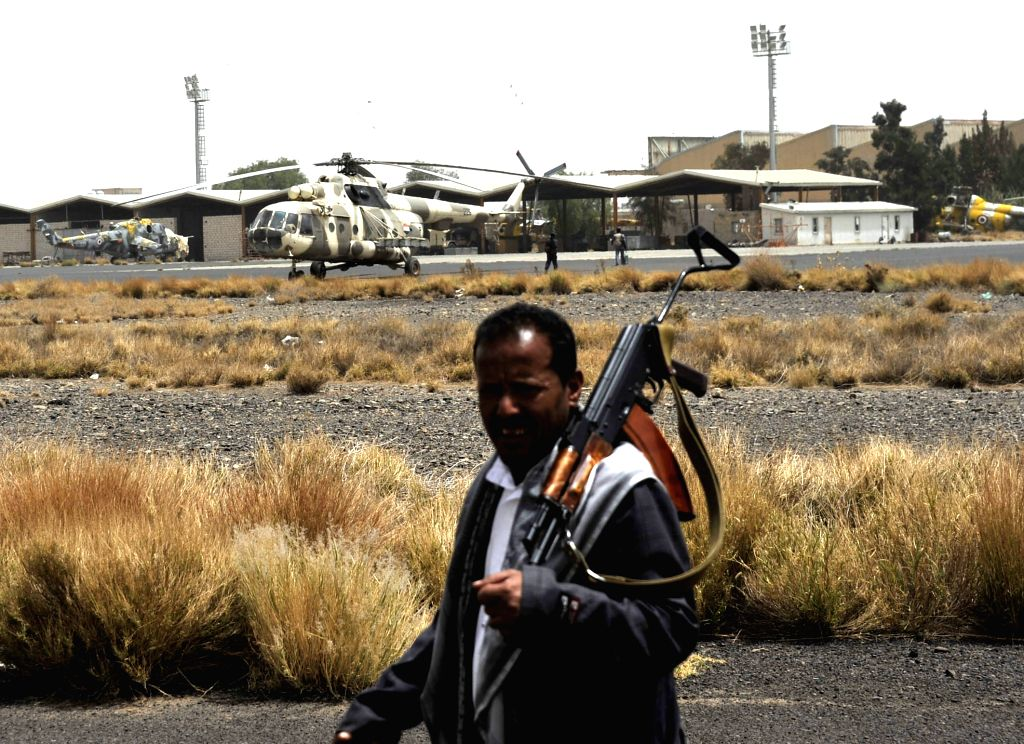 An armed man stands guard at Sanaa international airport, in Sanaa, Yemen, March 28, 2015. Earlier on Thursday, a Saudi-led Arab coalition launched airstrikes ...