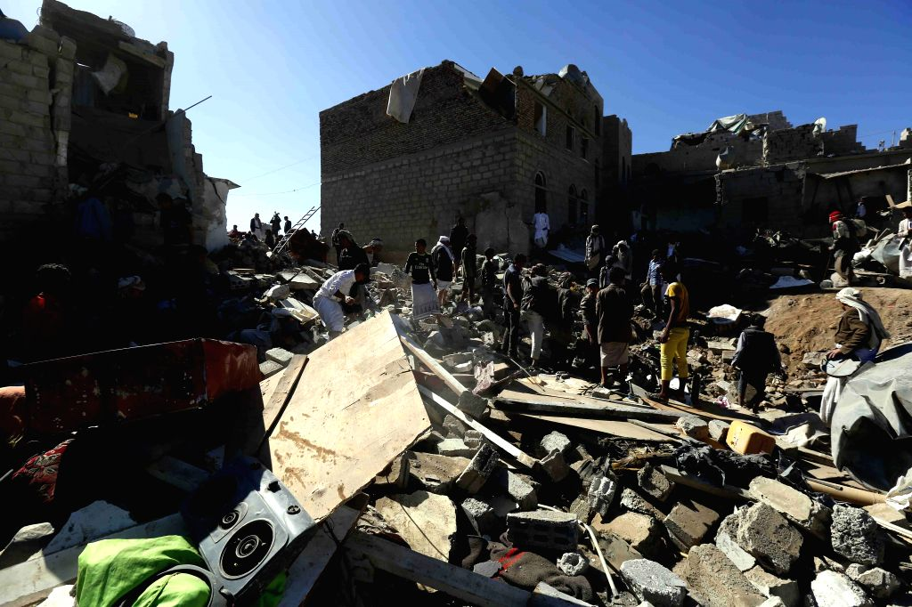 People clear rubbles after a residential neighbourhood was hit by warplanes in Sanaa, Yemen, on May 1, 2015. At least 21 civilians were killed when an overnight air ...