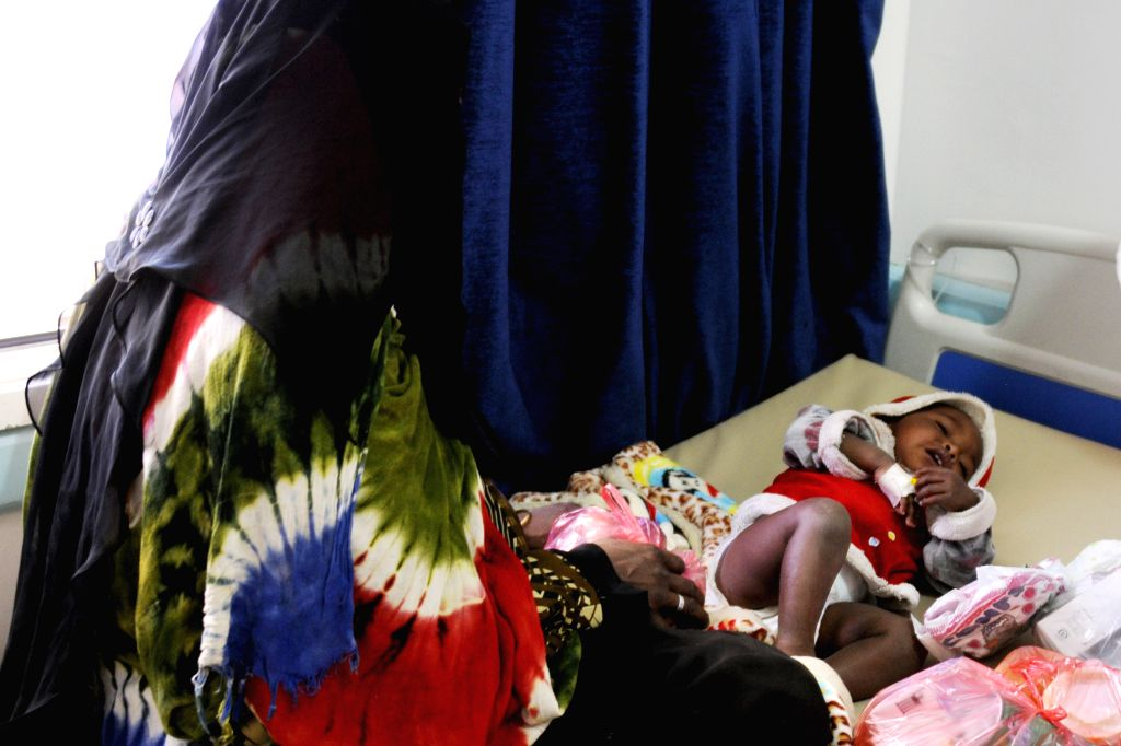 SANAA, May 29, 2017 - A woman sits beside her child who is infected by the cholera at the al-Sabeen hospital, in Sanaa, Yemen, May 28, 2017. According to the Office for the Coordination of ...