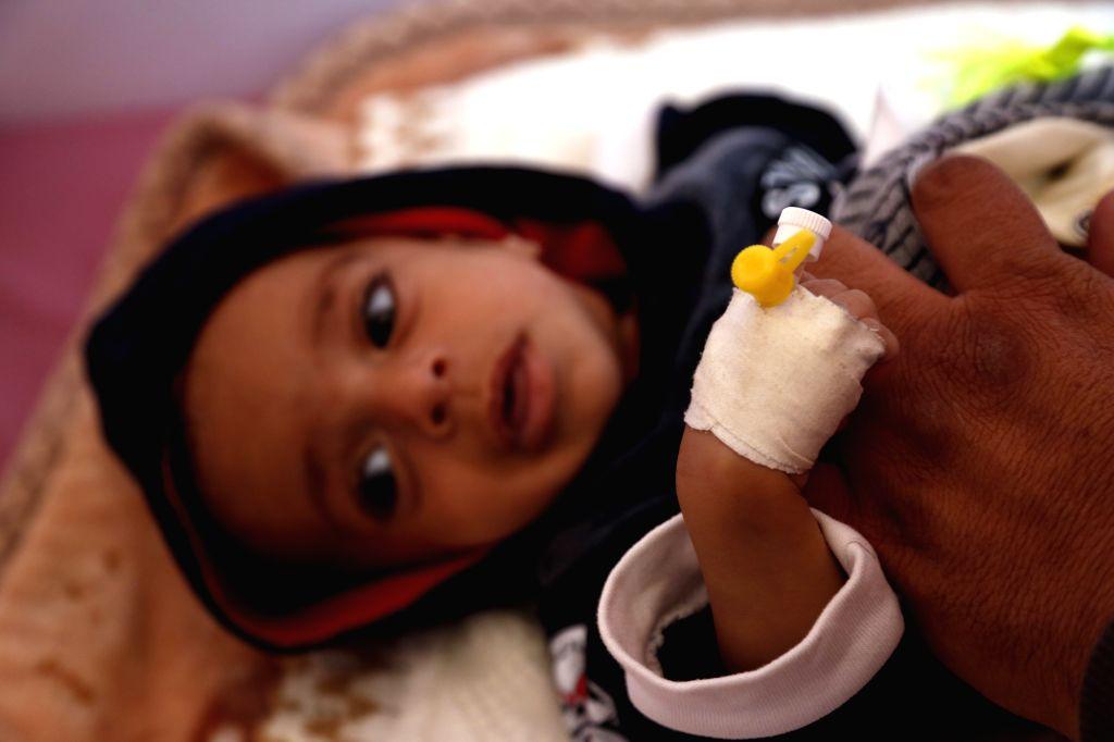 SANAA, Nov. 13, 2019 - A Yemeni child infected with malaria receives treatment at a hospital in Sanaa, Yemen, on Nov. 13, 2019. Yemen's health authorities declared a health emergency on Tuesday, ...