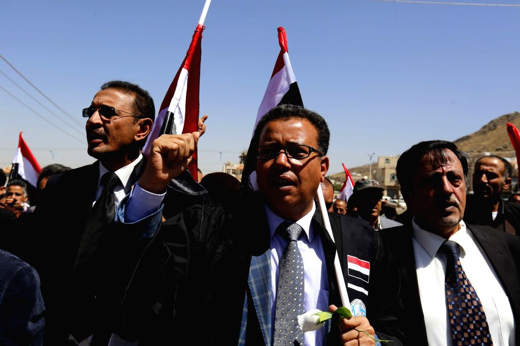 SANAA, Oct.15, 2016 - Yemenis shout slogans during a rally in solidarity and honor of the Oct. 8 airstrikes' victims outside the funeral hall, in Sanaa, Yemen, Oct. 15, 2016. The Saudi-led coalition ...
