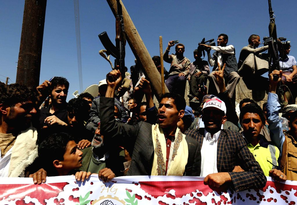 SANAA, Oct. 9, 2016 - People shout slogans during a rally protesting airstrikes on a funeral hall in Sanaa, Yemen, on Oct. 9, 2016. An airstrike hit a funeral hall packed with mourners in Yemen's ...