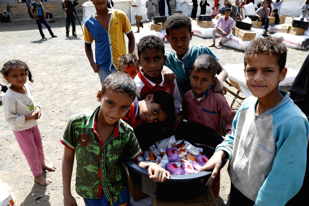 SANAA, Sept. 11, 2018 - Yemeni displaced children who fled their homes in Hodeidah receive supplies at a temporary camp in Sanaa, Yemen, on Sept. 9, 2018. According to a latest statement by the World ...