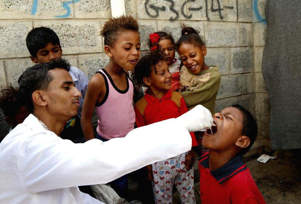 SANAA, Sept. 14, 2019 - A medical staff gives a child an oral anti-cholera vaccine in Sanaa, Yemen, Sept. 14, 2019. Yemeni Ministry of Public Health and Population launched on Saturday an emergency ...