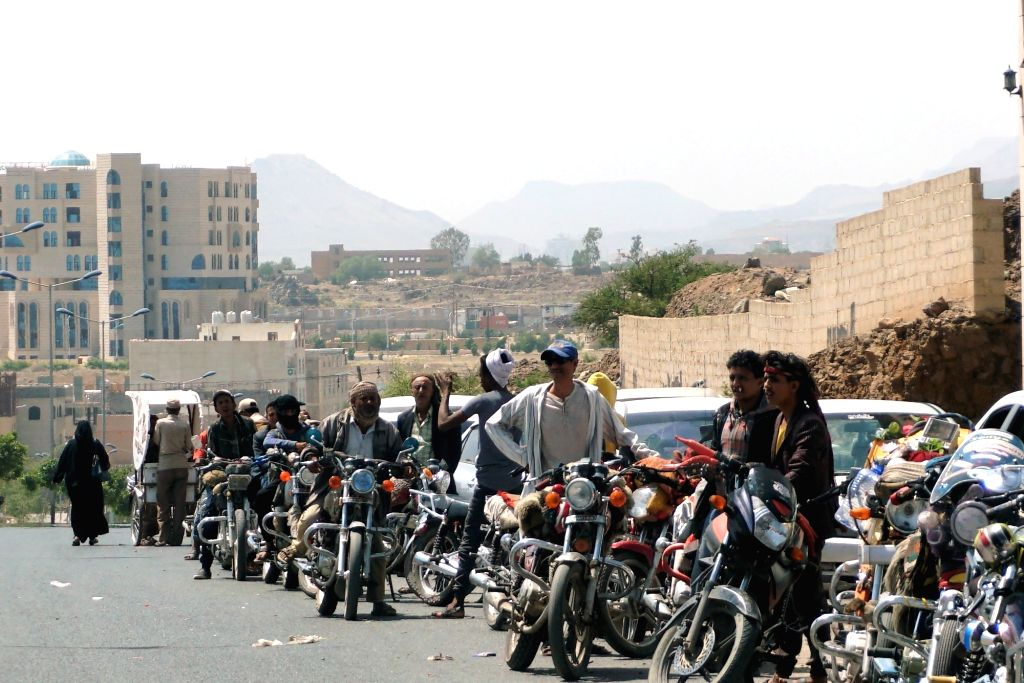 SANAA, Sept. 18, 2018 - Yemeni people line up with their motorcycles at a gas station in Sanaa, Yemen, on Sept. 18, 2018. Streets are almost empty in Yemen's capital Sanaa as a week-long severe fuel ...