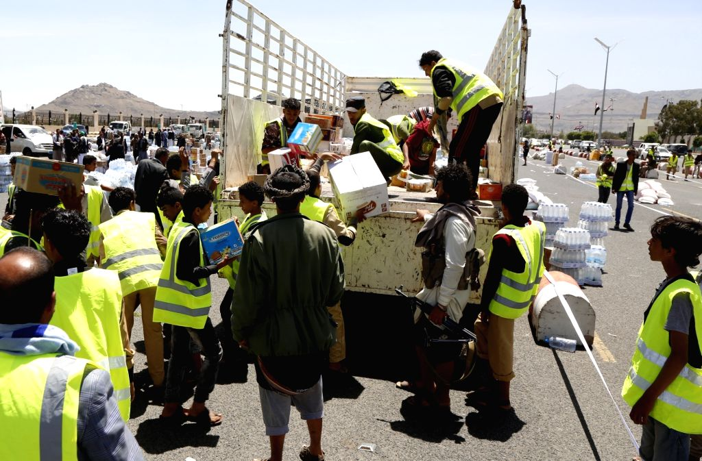 SANAA, Sept. 22, 2019 - Workers load supplies collected by the Houthis as battlefront reinforcements onto a truck in Sanaa, Yemen, Sept. 22, 2019. Pro-government Yemeni forces on Sunday blamed the ...