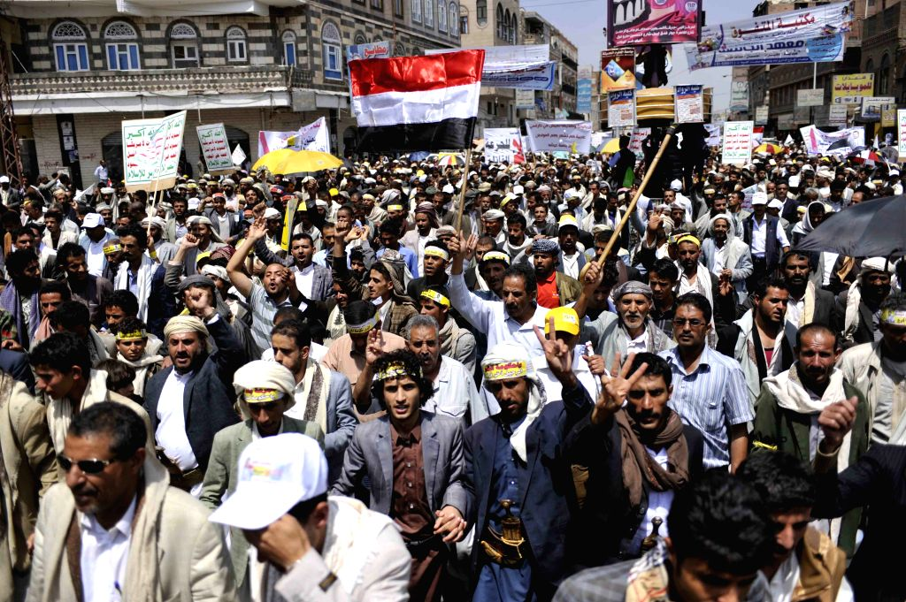 Protesters shout slogans during a demonstration in Sanaa, Yemen, on Sept. 9, 2014. At least one protester was killed and several others wounded when Yemeni riot ...