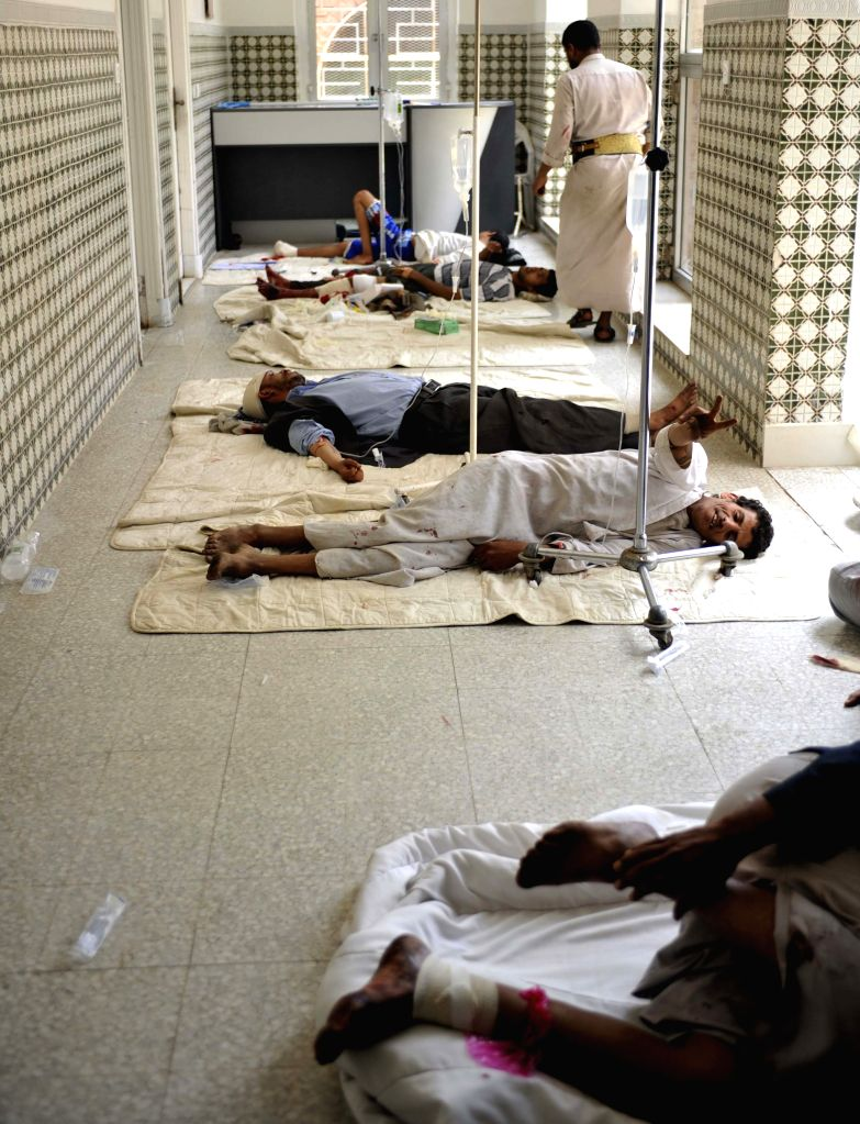 Protesters who were injured in clashes with riot police lie on the ground in a hospital in Sanaa, Yemen, on Sept. 9, 2014. At least one protester was killed and ...