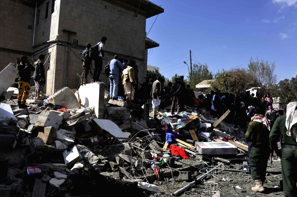 Yemeni security forces and civilians gather at the residence of the Iranian ambassador to Yemen after a powerful explosion in Sanaa, Yemen, on Dec. 3, 2014. A powerful car bomb hit the ...