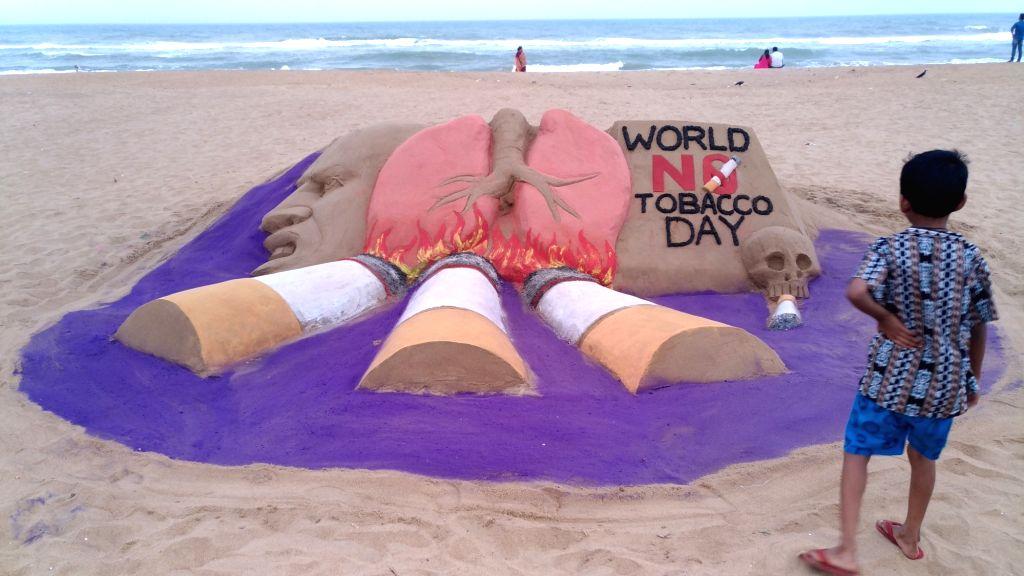 "Sand artist Manas Kumar Sahoo`s creation on World To ""World No Tobacco Day"" at Puri in Odisha on May 31, 2017. - Manas Kumar Saho"