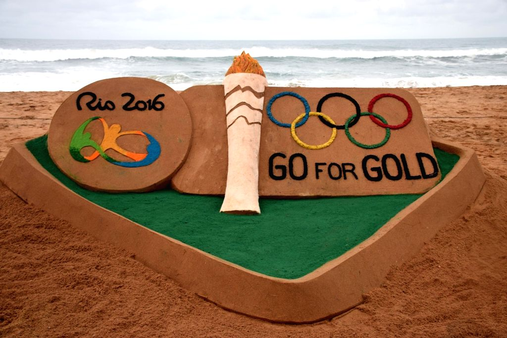 Sand artist Sudarshan Patnaik has created a sand sculpture to wish luck to Indian contingent at the Rio Olympics in Puri beach on Aug 4, 2016. - Sudarshan Patnaik