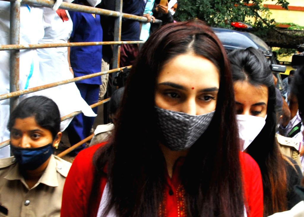 Sandalwood actresses Ragini Dwivedi and Sanjjanaa Galrani, arrested in the drugs racket case, come out of the KC General Hospital, after undergoing medical tests, in Bengaluru on Sep 14, ... - Ragini Dwivedi and Sanjjanaa Galrani