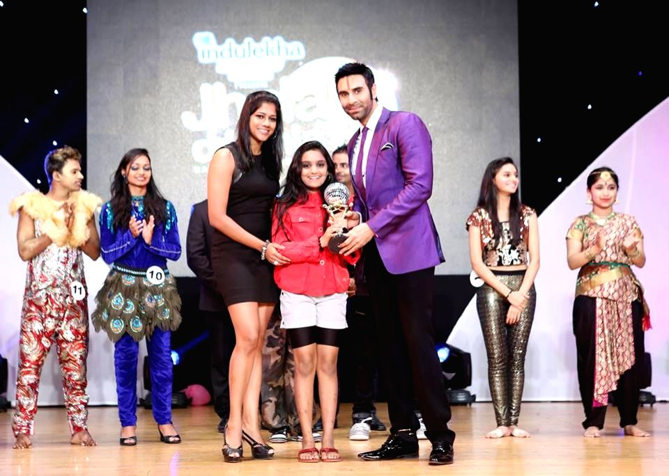 Sandip Soparrkar awarding contestant during `Jhalak Dikhhla Jaa UAE Season 3` grand finale at the Sheikh Rashid Auditorium, Indian High School in Dubai on June 24, 2014.
