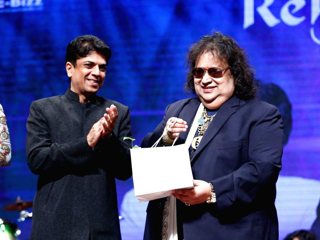"Sangeetam Trust Founder Saurabh Daftary and Music Composer Bappi Lahiri during the musical concert  ""Rehmatein 3"" in Mumbai."