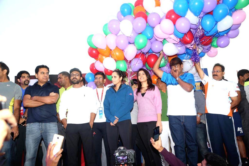 Sania Mirza, KTR, Ram Charan & Raashi Khanna at 10K Run in Hyderabad - Sania Mirza and Raashi Khanna