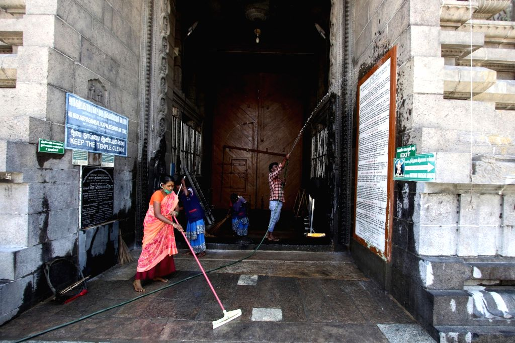 Sanitation staff busy cleaning the temple premises after the Tamil Nadu Government permitted the reopening of the places of worship as part of several relaxations that shall apply to the ...