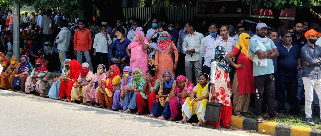 Sanitation workers picket against BJP, raised demand for salary at Pant Marg near Delhi BJP office on Tuesday, September 28, 2021.