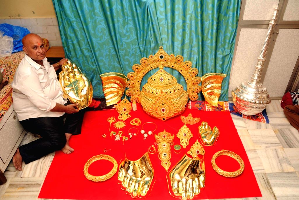 Sanjay Nana Vedak, displays gold ornaments made by him for Ganesh idols of different puja organisers at Girgaon in Mumbai on Aug 17, 2017.