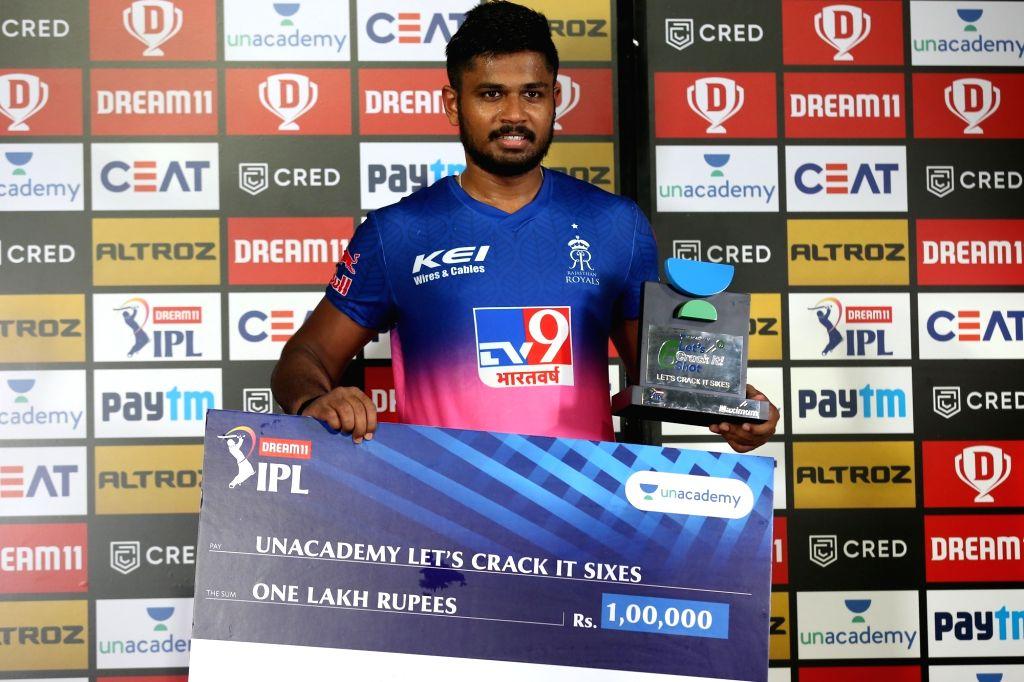 Sanju Samson of Rajasthan Royals received unacademy lets crack it six award during match 9 of season 13 of the Indian Premier League (IPL) between Rajasthan Royals and Kings XI Punjab held ...