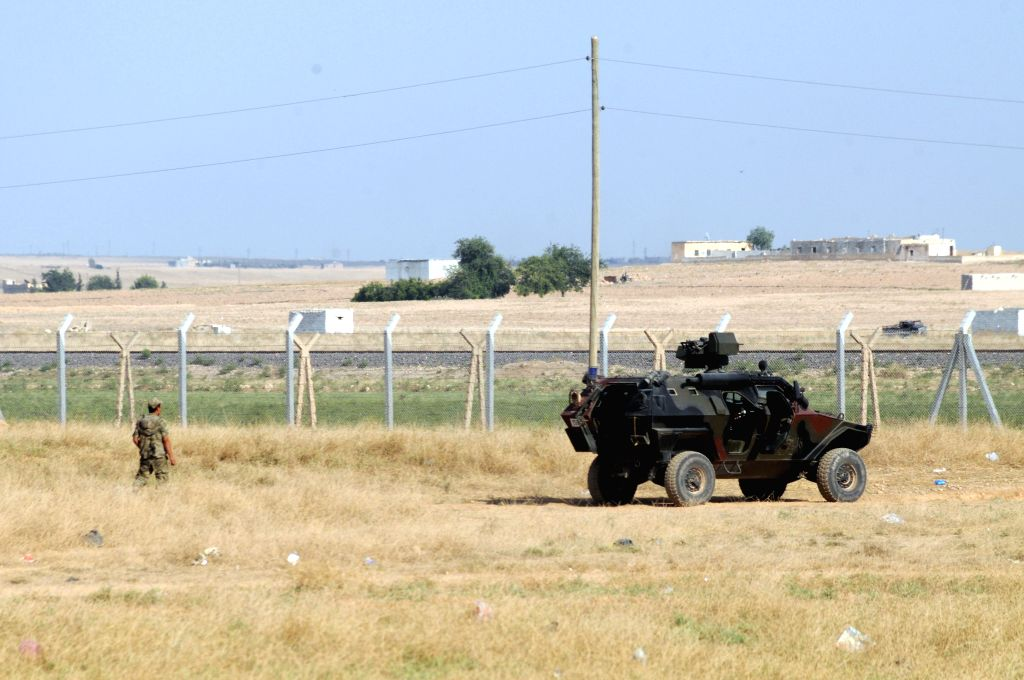 A Turkish military vehicle is seen at the border areas with Syria in Sanliurfa in Turkey, July 16, 2014. Turkey tightened security measures in its border areas ...